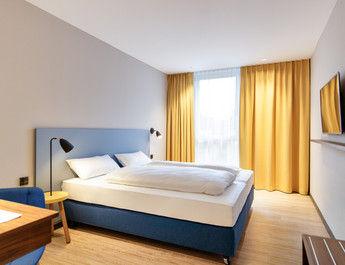 Schlicht und schön: Die Zimmer im neuen Arthotel Anna