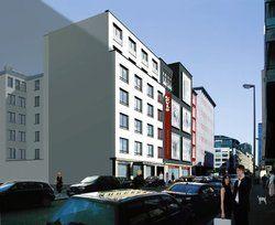 Klare Linien: <em>Die Fassade des neuen Hotels trägt die minimalistische Handschrift des Architekten Karl Dudler <tbs Name=