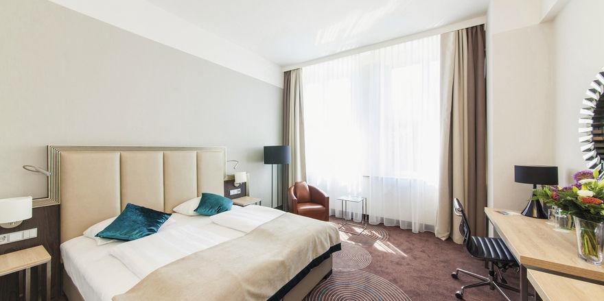 Elegant mit frischen Farbakzenten: Die Grundrisse der Zimmer sind ganz unterschiedlich.