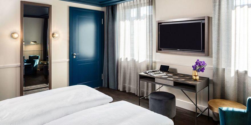 Stylisch: Die 93 Zimmer sind in Blau- und Grüntönen in Verbindung mit Kupferelementen eingerichtet