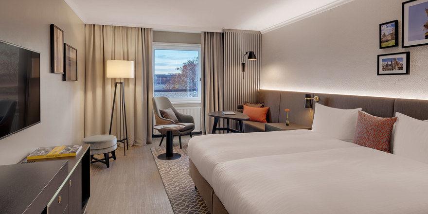 Frischer Look: Die neu gestalteten Zimmer punkten mit gedeckten Naturtönen und klarem Design.