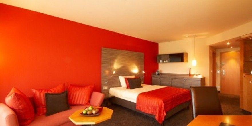 Neues Design: Rot- und Brauntöne dominieren in den Zimmern des Atrium Hotels Mainz