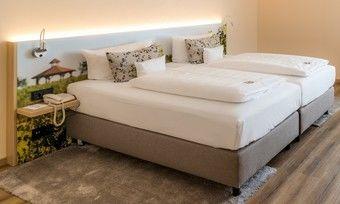 Neu im Palatin: Reben-Fotos hinter dem Bett