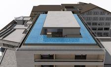 So soll es aussehen: Ein Rendering des künftigen Hotels Mooshof mit Pool auf dem Dach