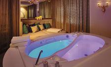 Klangwellenmassage für Paare: Doppelbadewanne in Ying & Yang-Form