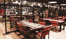 Viel Holz und Ledermöbel: Die Restaurants der Marke The Ash setzen auf den Stil der amerikanischen Supperclubs