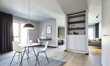 Skandinavisch schlicht: Designmöbel und -leuchten werden ergänzt durch für ipartment entwickelte Maßmöbel.